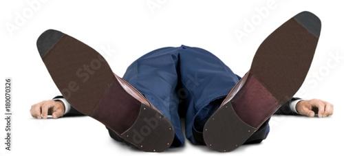 Fotografía  Portrait of a Businessman Lying Flat on his Back