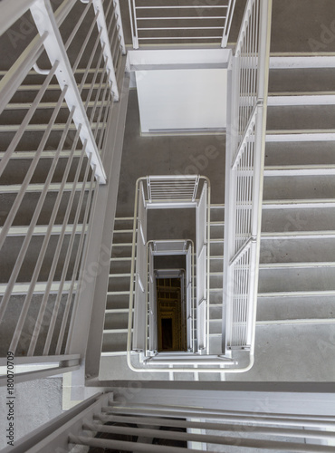 No One Is On The Stairs. The Stairs And Railing Are Gray. You Can Barely  See The Yellow Netting At The ...