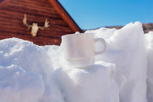 White Tea Cup On The Snow Cube.