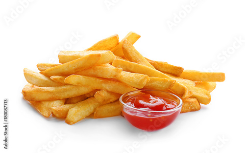 Yummy french fries with sauce on white background