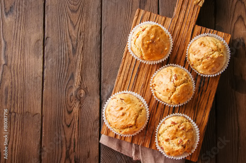 Fotografie, Obraz Homemade muffins with bacon and cheese on a wooden background