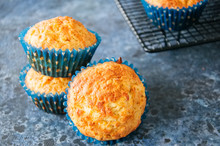 Homemade Apple Cheese Muffins On A Wire Rack. Blue Stone Background. Seasonal Baking.