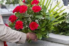 Leaving Flowers In A Graveyard