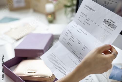 Valokuva  Closeup of hand holding invoice paper