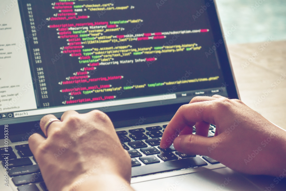 Fototapeta Programming Work Time. Programmer Typing New Lines of HTML Code. Laptop and Hand Closeup. Working Time. Web Design Business Concept.