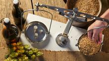 Man Weighs Malt For Home Brewi...