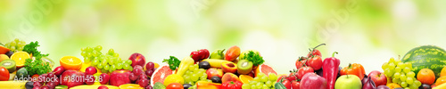 Panoramic collection fresh fruits and vegetables for skinali on blur green background. © Serghei Velusceac