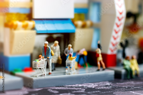 Miniature people family with shopping cart in supermarket, Tourism, shopping or business concept Canvas Print