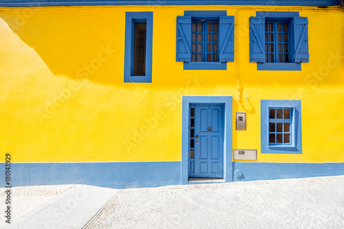 Fotografie, Obraz  Beautiful yellow building facade in the old town of Aveiro city in Portugal