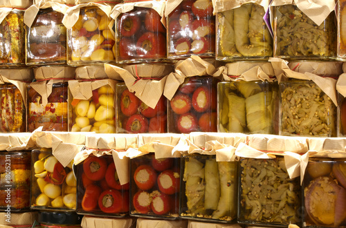 Fotografie, Obraz  jars of typical Italian products with zucchini, peppers, garlic