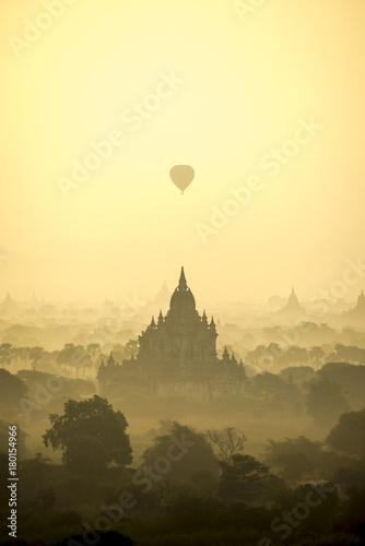 Fotobehang Zwavel geel Sunrise scene hot air balloons fly over pagoda ancient city field in Bagan Myanmar. (High image quality)