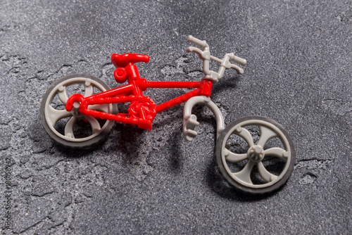 Deurstickers Fiets Small broken toy bicycle
