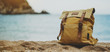 Hipster hiker tourist yellow backpack closeup on background blue sea sunset ocean horizon, panoramic seascape sunrise blank mockup, traveler relax holiday concept, sunlight view in trip vacation