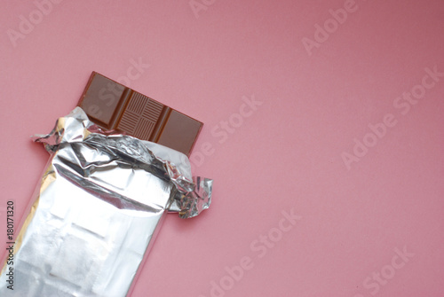 Chocolate on a Foil on a Pink Background in Corner Isolated Wallpaper Mural