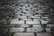 Pattern of a black and white cobblestones on a road