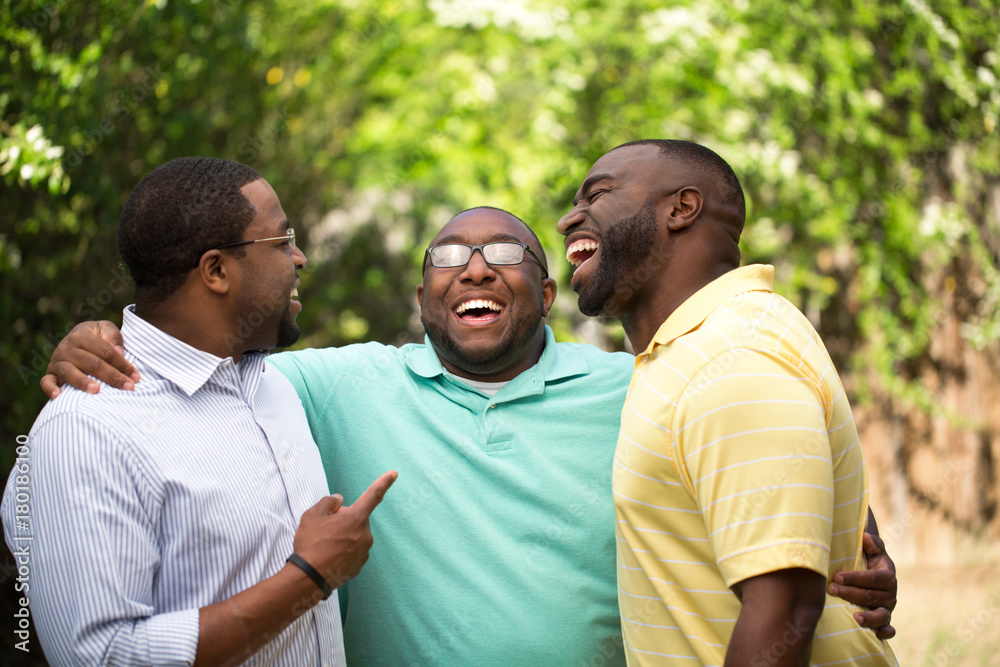 Fototapety, obrazy: Brothers laughing and talking.
