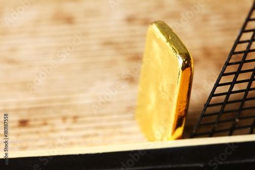 Keuken foto achterwand Schip Gold bar put on the floor of miniature ship model scene.