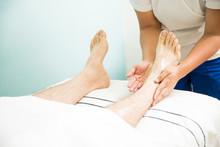Man Getting Foot Rub In A Spa
