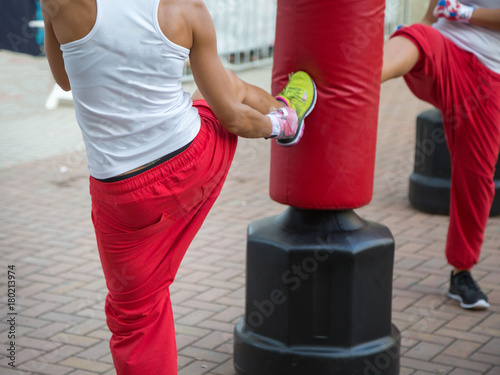 Photo  Young Girl at Gym: Boxing Workout with Red Punching Bag