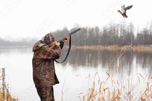 Aluminium Prints Hunting hunter shooting to the flying duck