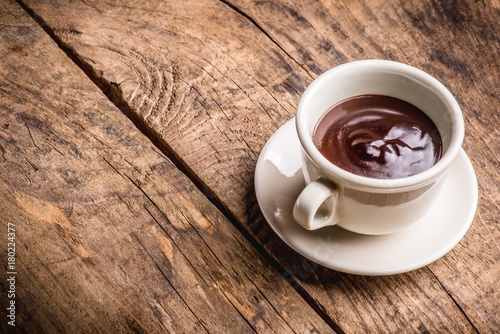Canvas Prints Chocolate chocolate cup on wooden table