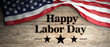 Leinwanddruck Bild - United States flag with happy labor day message placed on wooden background. 3d illustration