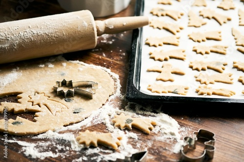 Baking Christmas Cookies / Cookie cutter, rolling pin, dough and baking sheet on wooden table