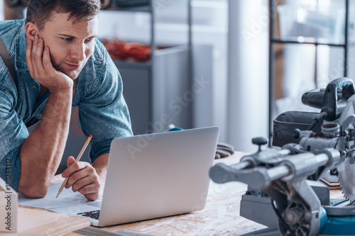 Handyman working using laptop