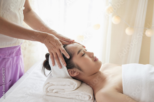 Poster Spa Young woman with thai massage.
