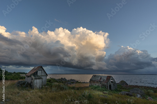 Abandoned houses in the Baltic Sea. Shore, nature and ruins facilities architecture concept. Mohni, small island in Estonia, Europe.