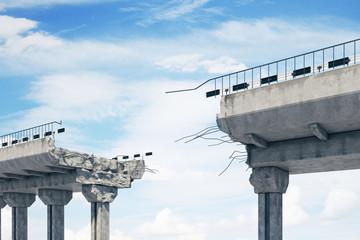 Broken bridge on sky background