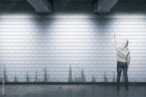 Man painting graffiti