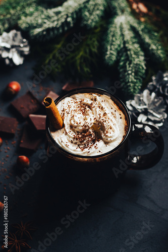 Spoed Foto op Canvas Chocolade hot chocolate in a Christmas atmosphere, dark mug with whipped cream