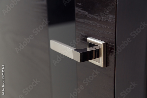 Obraz Closeup handle. Modern door handle, tilt view. - fototapety do salonu