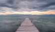 Pier at South Corfu Greece during sunset on a cloudy day.