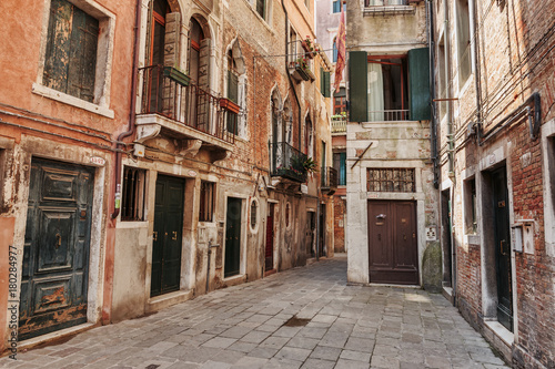 Fototapety, obrazy: Narrow street in the old town in Venice Italy