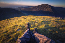 POV Hiker Laying On Mountain Top At Sunset