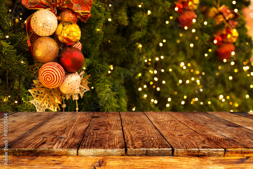 Christmas Tree Background With Decoration And Blurred Light Bokeh Empty Dark Wooden Deck Table For