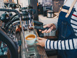 Woman barista using machine making coffee, Close up hand holding a coffee cup.