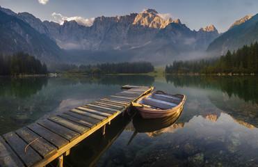 wooden bridge over a mountain lake