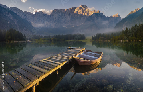 wooden bridge over a mountain lake