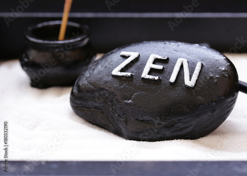 Foto op Canvas Zen stone with the inscription Zen - a symbol of peace and balance