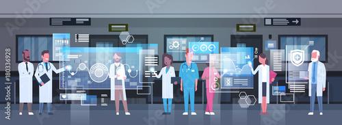 Fotografia  Group Of Medical Doctors Using Digital Monitor Working In Hospital Medicine And