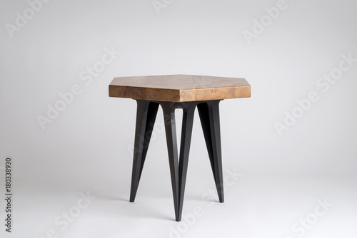 Fotografie, Obraz  Modern Wooden Stool with Hexagonal Top and Black Legs