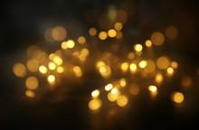 Abstract Bokeh Background Of Golden Light Burst Made From Bokeh Motion