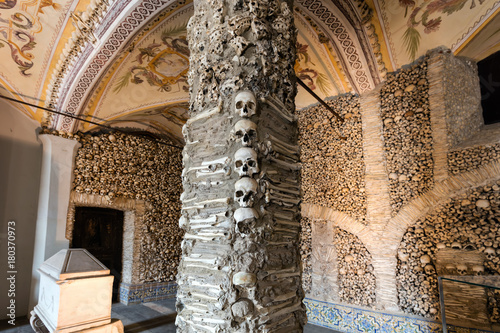 Fotografie, Obraz  Evora, Portugal, August 17, 2017: Capela dos Ossos was built in the 16th century by a Franciscan monk to prod his fellow brothers into contemplation and transmit the message of life being transitory