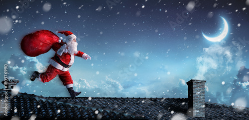 Photo  Santa Claus Running On The Rooftops