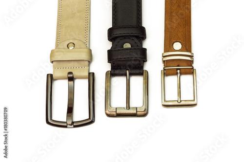 Valokuva Three leather belts lie on a white background