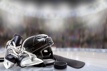 Ice Hockey Helmet, Skates, Stick And Puck In Rink