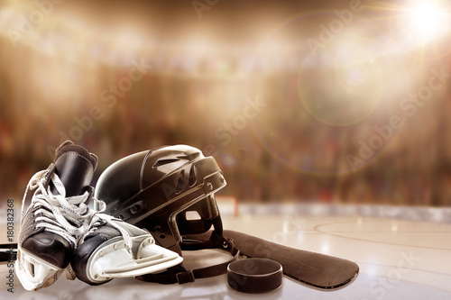 Ice Hockey Helmet, Skates, Stick and Puck in Fictitious Rink With Special Lighting Effects and Copy Space